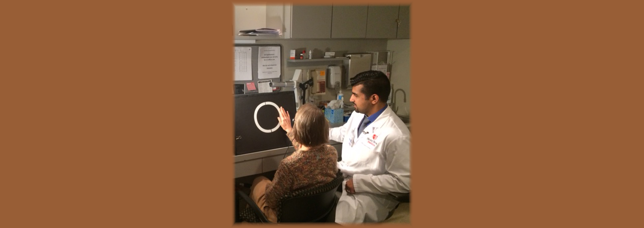 Dr. Khurram Chaudhary, a retinal surgeon at Stony Brook Medicine with patient Linda Kirk