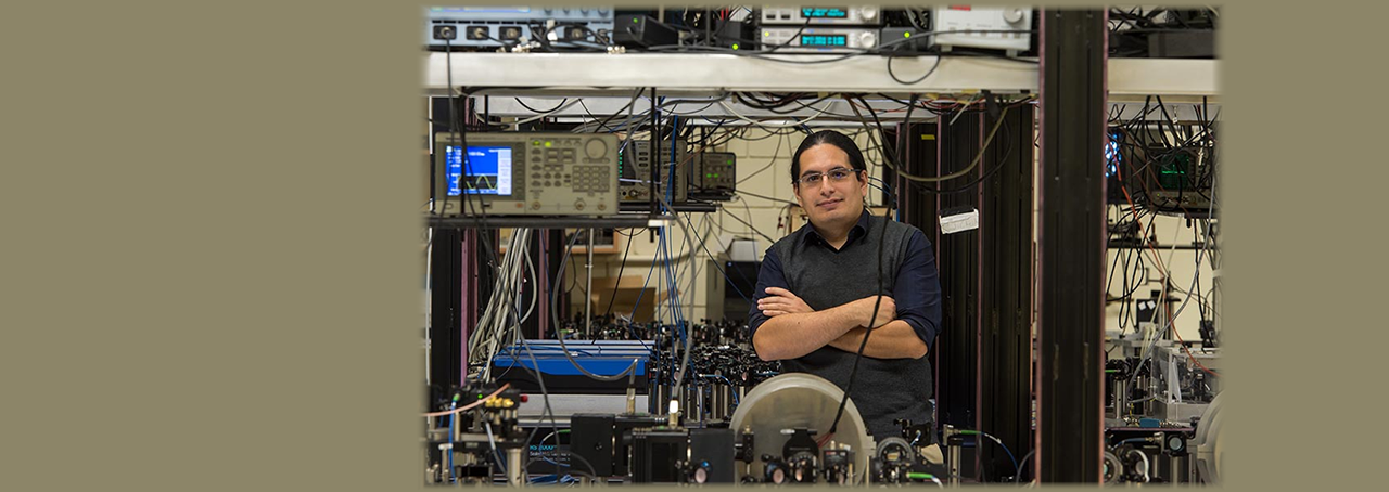 Associate professor of physics at Stony Brook University, Eden Figueroa in his lab